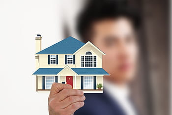 Person holding house